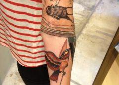 Tatuaje pájaros en el brazo