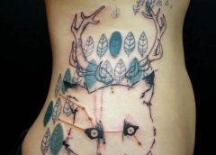 Tatuaje cabeza de zorro en el abdomen