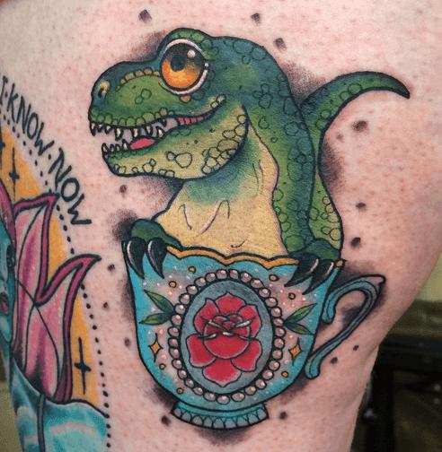 Tatuaje dinosaurio verde